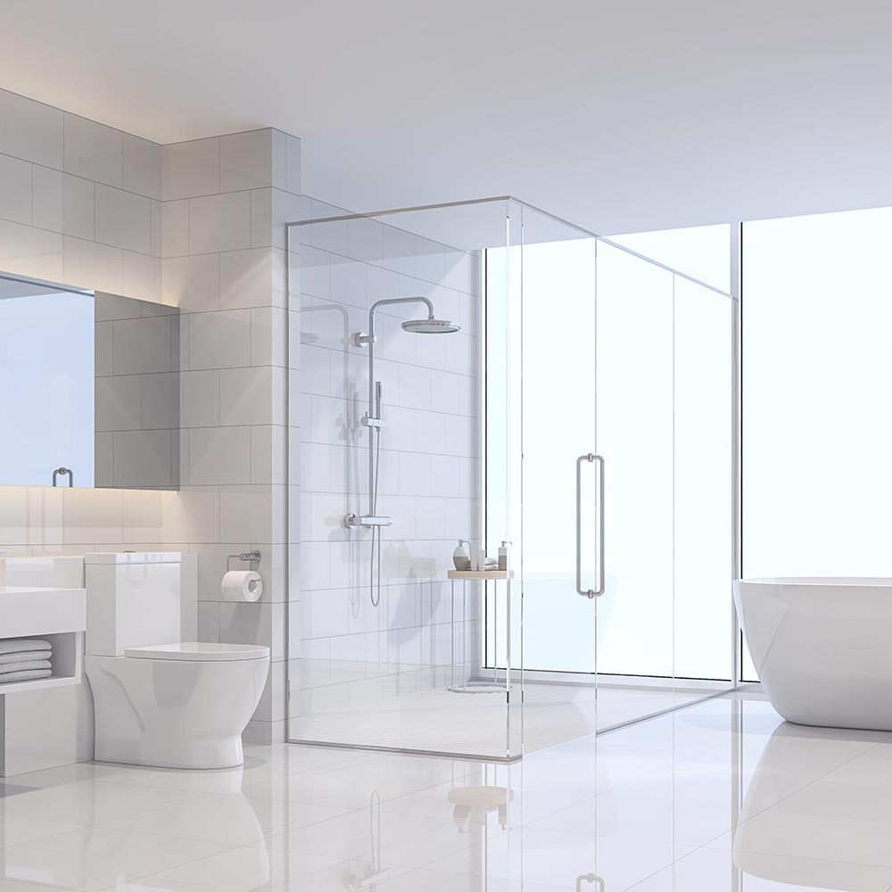 Modern white bathroom 3d rendering image. There are white tile wall and floor.The room has large windows. Looking out to see the scenery outside.