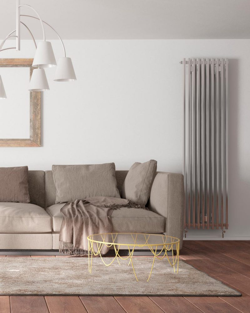 modern room with heating battery,sofa,pillows,plaid,carpet,table and frame